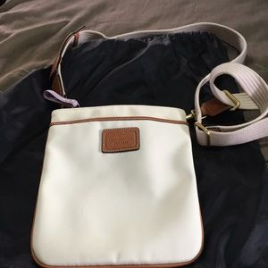 White crossbody Coach bag w/ brown leather accents